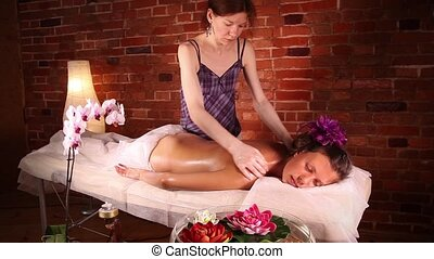 Massage in the health spa - Massage specialist massaging...