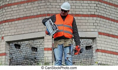 Builder with tools near to the