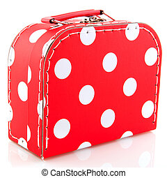 Red spotted suitcase for luggage while on vacation