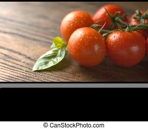 red tomatoes with basil on wood - red tomatoes with green...