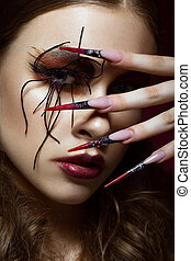 woman in the image of spider with creative art makeup and...