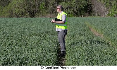 Farmer writing and walking on the