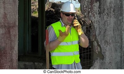 Construction worker talking on smart phone