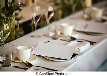 Served table with invitation, bokeh - Table setting at...