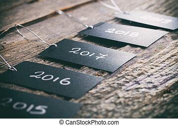 "Pricing tags in a row with ""2017"" focus and other years text..."