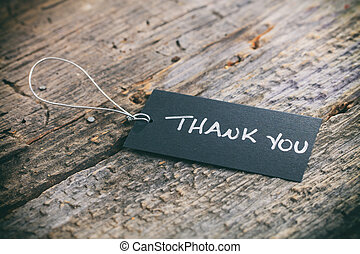 "Closeup of pricing tag with twine and ""Thank you"" text on..."