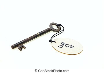 "A wooden tag with ""gov"" text on old rusty key, isolated on..."