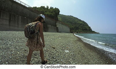 Girl on beach summer - In Black sea on shores of beautiful...
