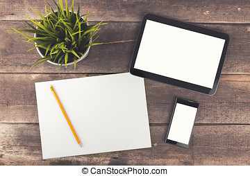 workspace with digital tablet, phone and blank paper on wooden table