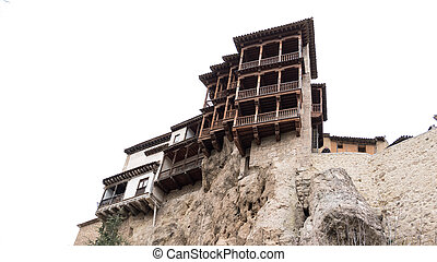 The famous hanging houses in Cuenca against white sky - Wide...