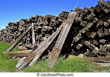 Huge pile of old railroad ties - A huge pile of stacked...