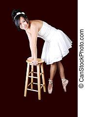 Ballerina standing in her ballet slippers.