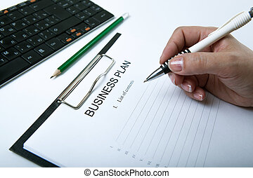 businesswoman filling business plan - man holding a pen and...