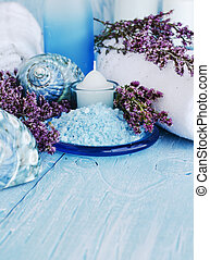 flowers lying on and candle Spa set - flowers lying on a...