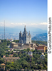 Tibidabo church on mountain in Barcelona with christ statue...