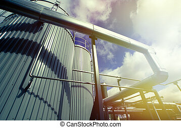 Industrial zone, Steel equipment against blue sky -...