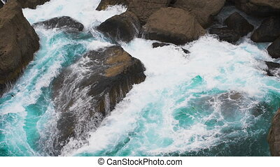 Power of nature. the waves of the sea rolled on coastal rocks.