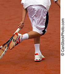 young tennis player hits theball