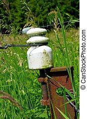 Porcelain insulator on a metal picket - Porcelain insulator...