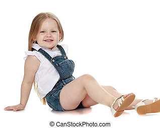 Girl in denim overalls - Laughing little girl with long...