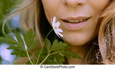 young woman smelling brings