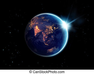 City lights at night in planet earth with with sun rising,...