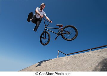 BMX Bike Stunt tail whip - Bmx rider performing a tail whip...