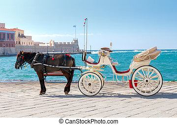 Chania. Horse-drawn carriage. - The elegant horse-drawn...