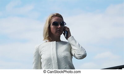 business blonde talking on the phone