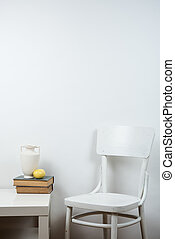 chair and empty wall background, interior art poster mock up...