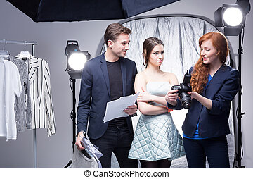 Showing the results of a fashion photo shoot - Young female...
