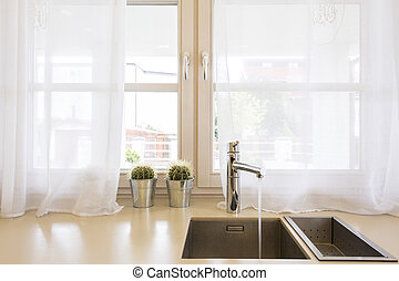 Functional kitchen design - Close up of a kitchen sink,...