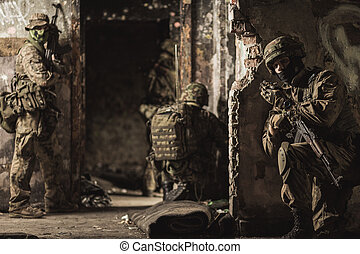 Soldiers and modern warfare - Group of armed and uniformed...