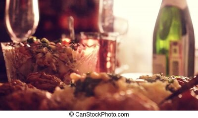 Decorated table with Glass of wine with food on table in...