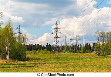 High-voltage power line in natural landscape - High-voltage...