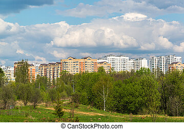 Natural summer landscape with city in distance