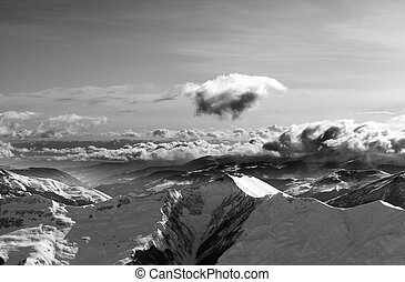 Black and white winter mountains at evening and sunlight...