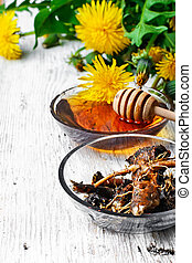Healing dandelion root - bowl of healing infusion of the...