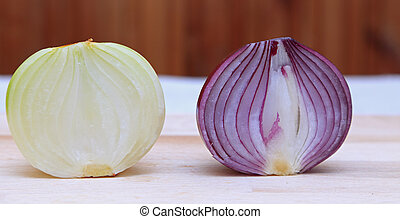Onions - Image of two different halves of onions on a...