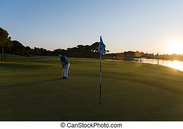 golfer hitting ball to hole - golf player hitting ball with...
