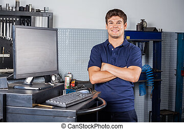 Confident Technician Standing Arms Crossed In Repair Shop