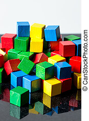 colorful toy blocks with reflections