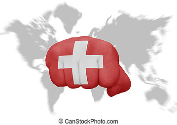 fist with the national flag of switzerland on a world map background