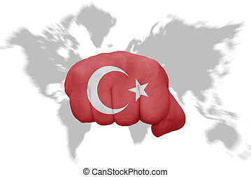 fist with the national flag of turkey on a world map...