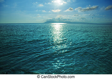 High contrast sea or ocean surface texture at sunset. - High...
