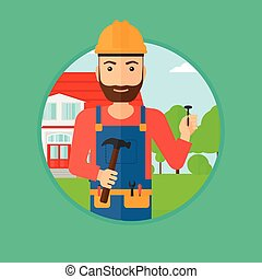 Cheerful builder with hammer. - A hipster builder with the...
