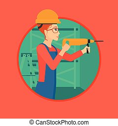 Worker with hammer drill - A female worker drilling a hole...