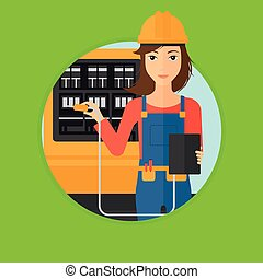 Electrician with electrical equipment - A woman in helmet...