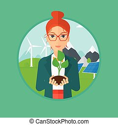 Woman holding green small plant.