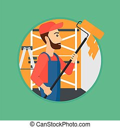 Painter with paint roller. - A hipster painter in overalls...
